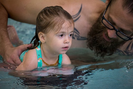Jared Uher works with his daughter, Adeline Uher, 1, during Little Snapper swim lessons on Oct. 29, 2018, at Hubbard Family Swim School in Phoenix.