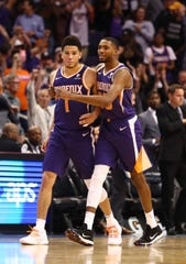 Devin Booker is grabbed by rookie Mikal Bridges after his game-winning basket in the closing seconds of the Suns' 102-100 victory over the Grizzlies on Nov. 4 at Talking Stick Resort Arena.