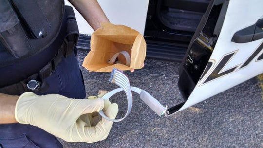 An example of a skimming device that criminals install inside an Arizona fuel pump to steal customers' card numbers.
