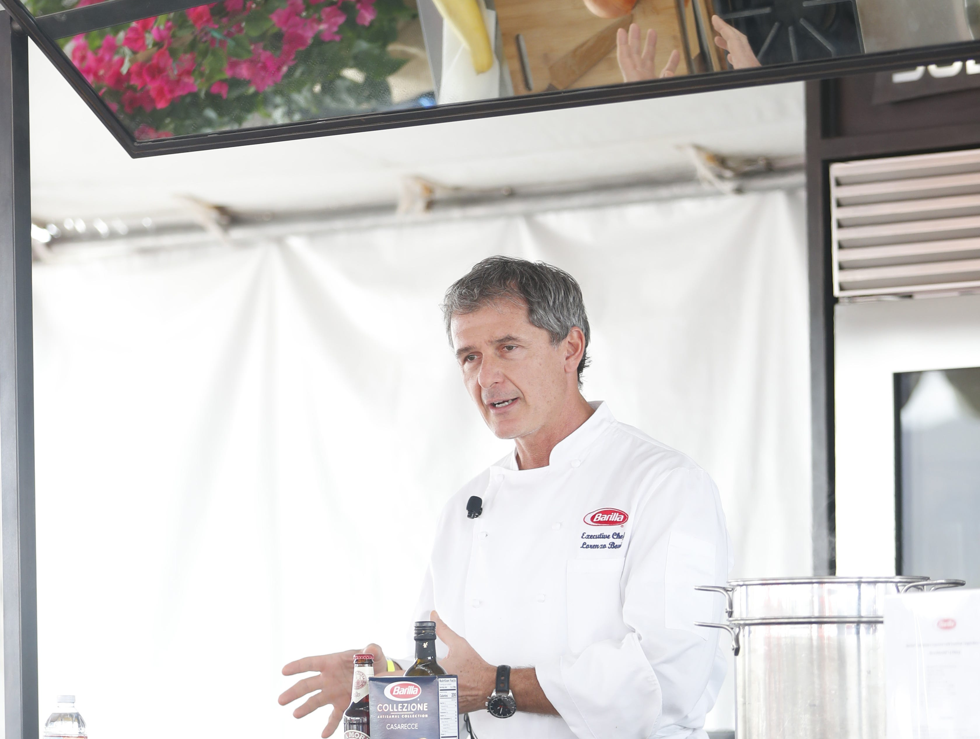 Chef Lorenzo Boni speaks while making a dish during a demonstration during the azcentral Wine & Food Experience at WestWorld of Scottsdale, Ariz. on November 4, 2018.