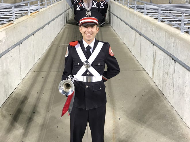 Adam Wells fulfilled a longtime dream when he was chosen to join The Ohio State University Marching band. He first heard the band play during a football performance at Port Clinton High School.