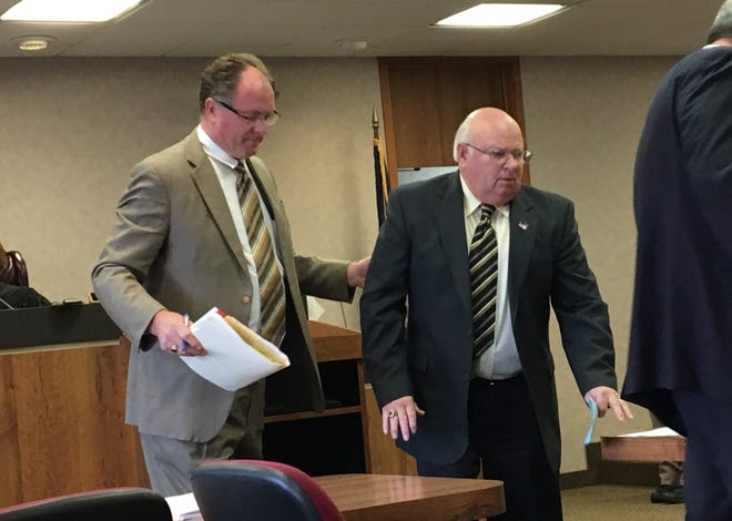 Retired Clay Township police officer Graham Rummel, right, is ushered out of the courtroom Monday, Nov. 5, 2018, by his attorney, Donnell Robinson, after being sentenced to two years' probation for an April shooting altercation. Rummel apologized for his actions.
