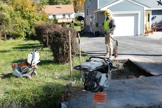 Workers with Central Hudson Gas and Electric Corp finish up hooking up a residence to a newly installed upgraded gas main in Cornwall on Oct. 31, 2018. The new mains are made of polyethylene plastic and replaces cast iron lines.  All houses connected to the old lines are required to be upgraded to match the new lines.