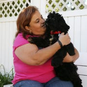 Stefani Timpano with her dog Bear, at her home in the City of Poughkeepsie on October 12, 2018. Timpano fostered Bear and ultimately decided to adopt him.