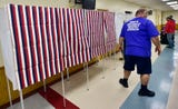 Voting booths are installed by county workers and a a crew from Zody's Moving & Storage at Fayetteville Fire Co. event hall.