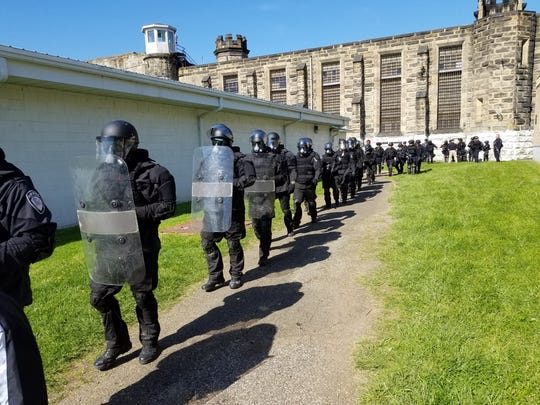 Correctional Emergency Response Teams prepare for a training exercise.