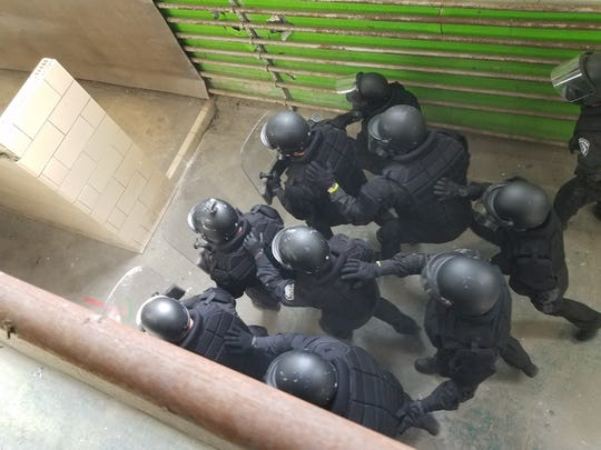A Correctional Emergency Response Team moves in a training exercise.