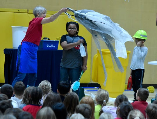 Kathleen Jacobs of Kathleen Jacobs & Puppets,  explains how York's combustion system turns trash into energy with the help of students Alanna Hopkins and Bryson Schmit at Loganville-Springfield Elementary School, Monday, November 5, 2018. 