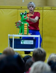 Kathleen Jacobs of Kathleen Jacobs & Puppets, presents a puppet show about recycling at Loganville-Springfield Elementary School, Monday, November 5, 2018. 