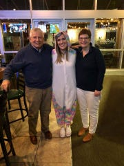 From left, George Labecki, Lindsay Wenrich, and George's wife, Lee Ann Labecki, pose for a picture before the surgery on Oct. 26.