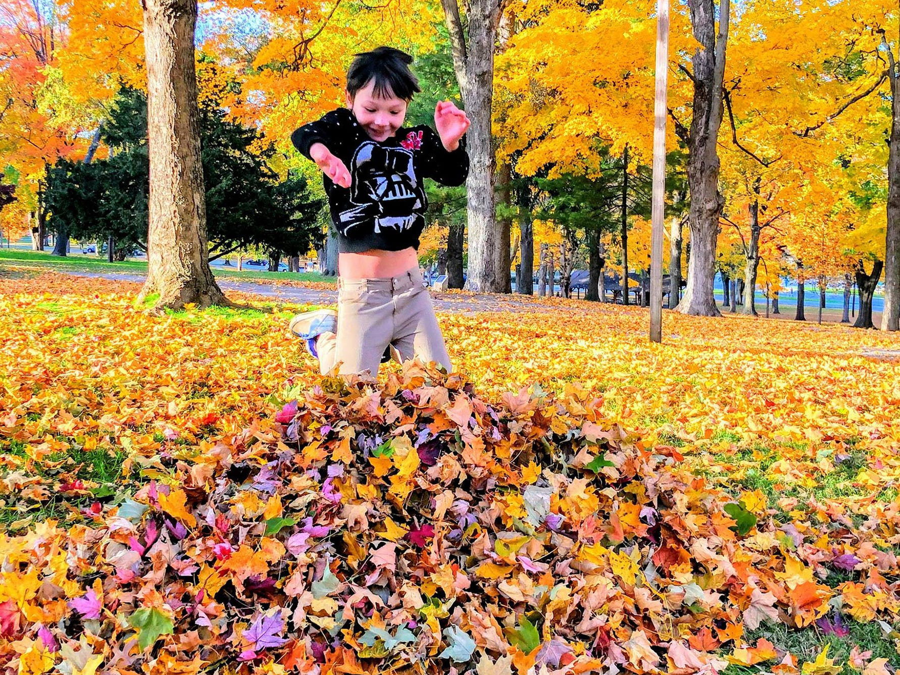Missy Richter Manning caught a leaf pile getting jumped on at Farquhar Park in York