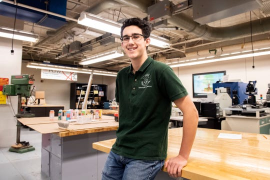 Noah Genco, a 16-year old junior enrolled in the International Baccalaureate physics program, smiles for a portrait on Wednesday, Oct. 24, 2018.