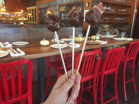 At Fantasies in Chocolate 2018, Campo is serving chocolate cake pops festooned with bacon.