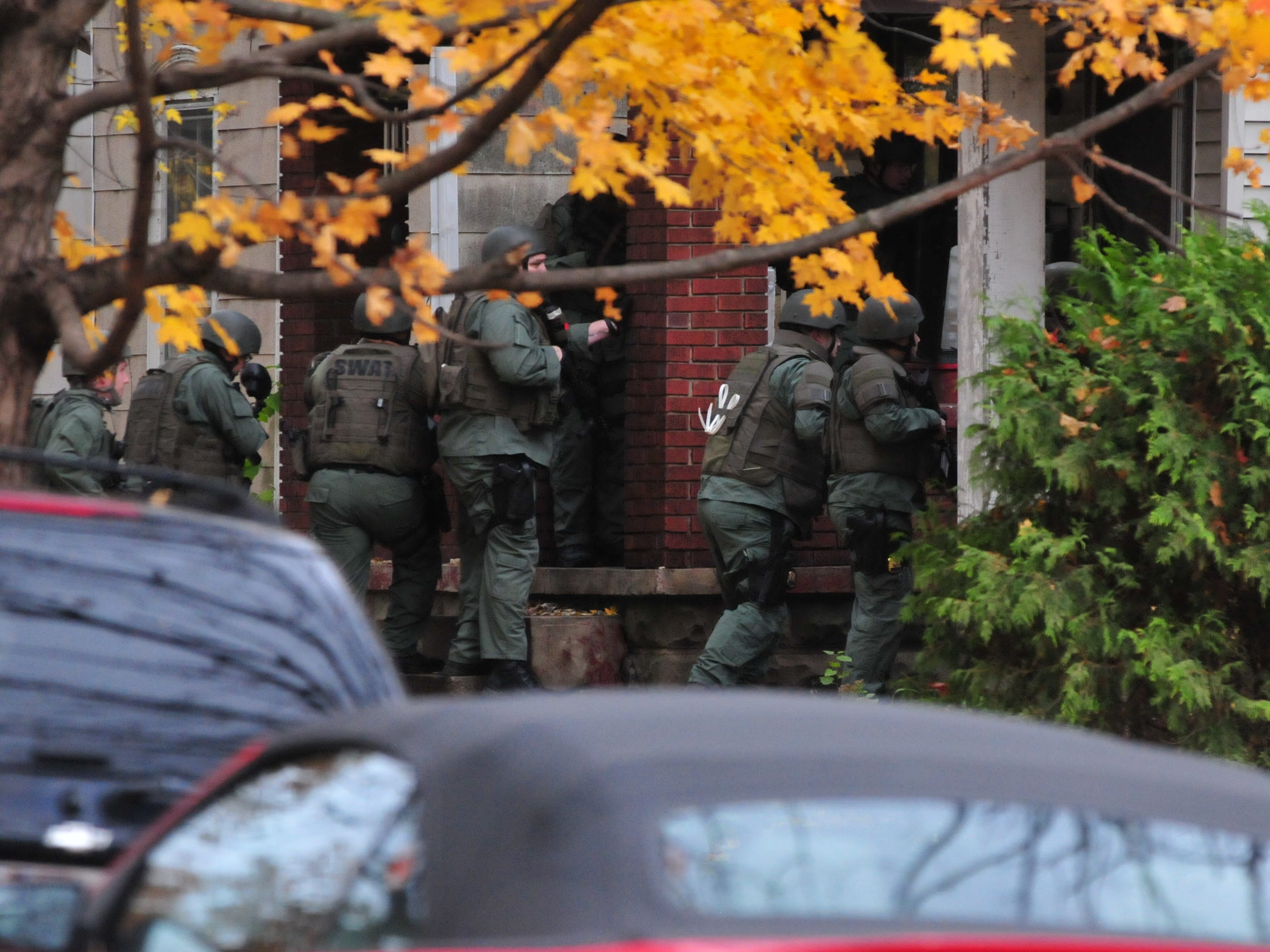 SWAT team members gather outside 219 N. 16th St. about 12:30 p.m. Monday.