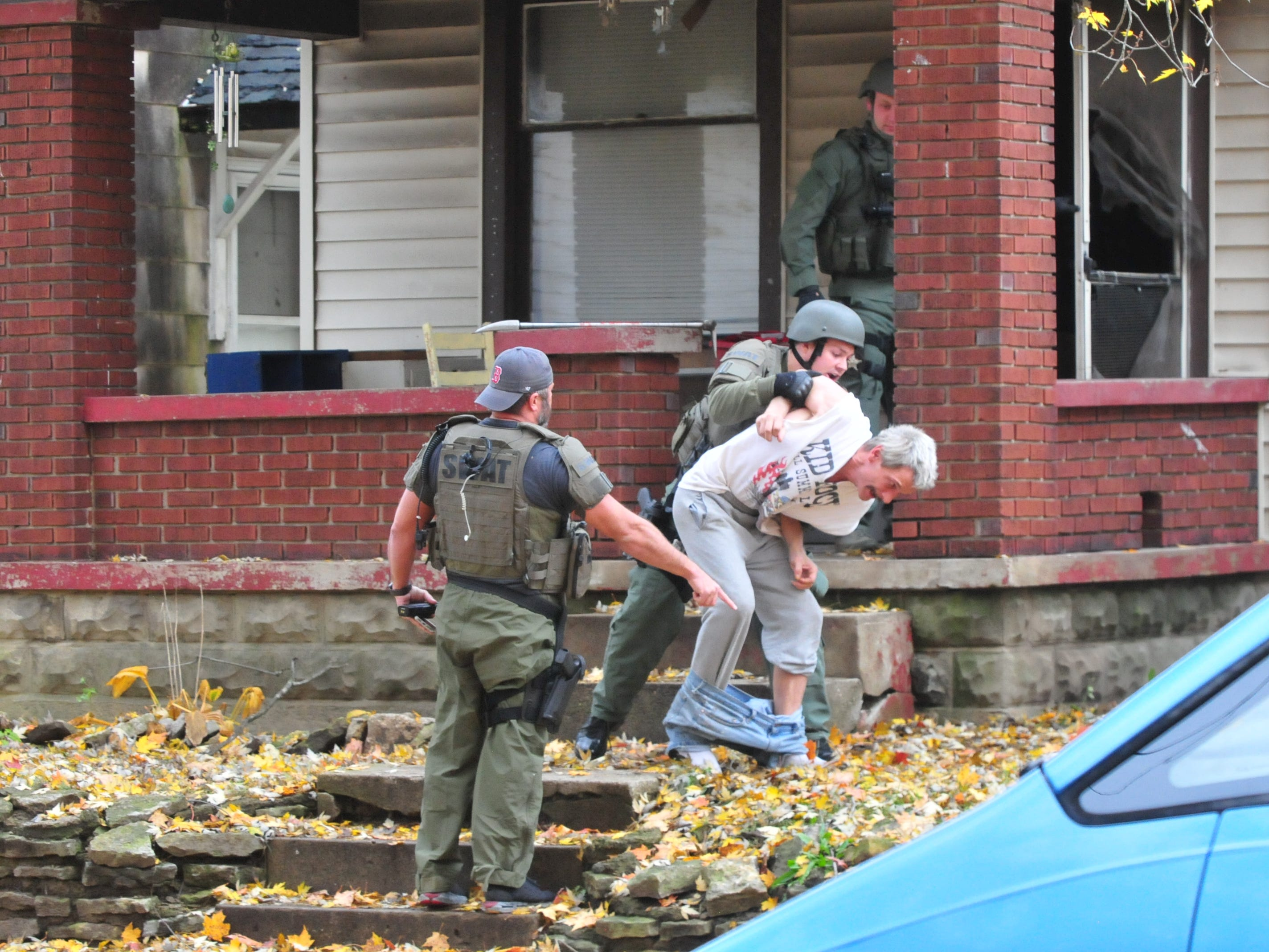 James Hamilton is ordered onto his stomach outside 219 N. 16th St. during a SWAT raid Monday.