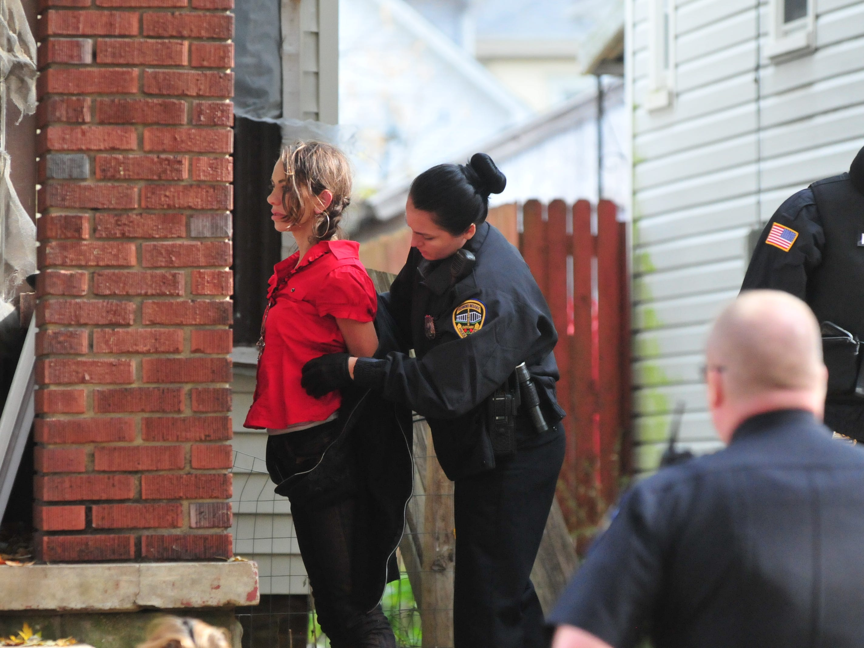 Richmond Police Department Officer Seara Burton searches Breckin Strickland during a SWAT raid Monday.