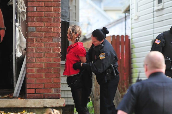 Richmond Police Department Officer Seara Burton searches Breckin Strickland during an arrest. Burton is one of 30 current RPD officers hired within the past four years.