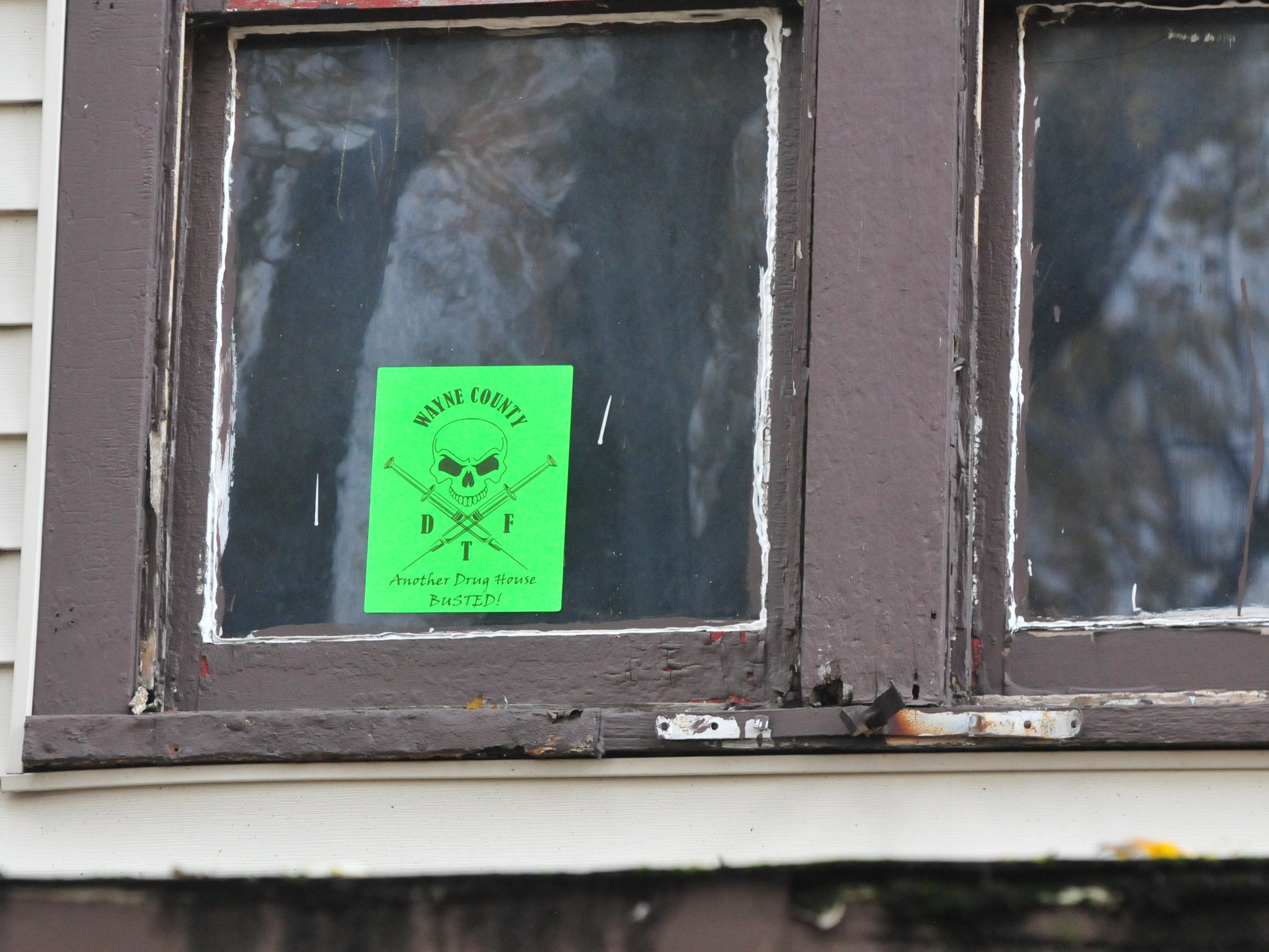 A sticker is attached to a window at 219 N. 16th St. saying the Wayne County Drug Task Force has shut down another drug house.