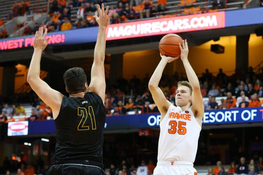 Syracuse freshman Buddy Boeheim shoots the ball against the defense of Jeff Allen of St. Rose during an exhibition game last month.