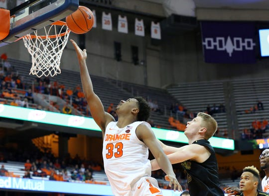 Syracuse junior Elijah Hughes, a transfer from East Carolina, shoots the ball past Matt Cerutti of St. Rose during an exhibition game last month. Hughes should provide the Orange with added depth this season.