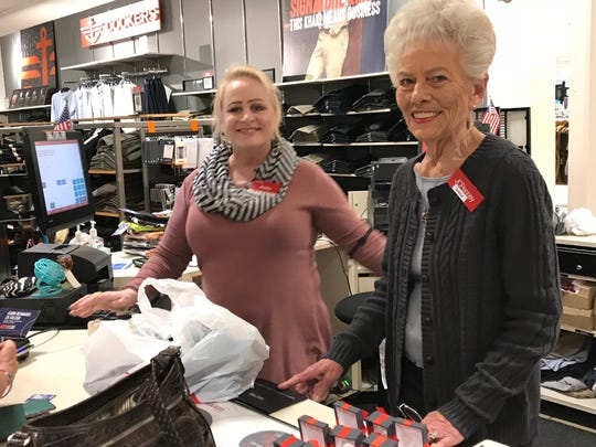 New JCPenney employee Sheila Dickens, right, was paired for training with Shelley Birk, who has worked at the store for 21 years.