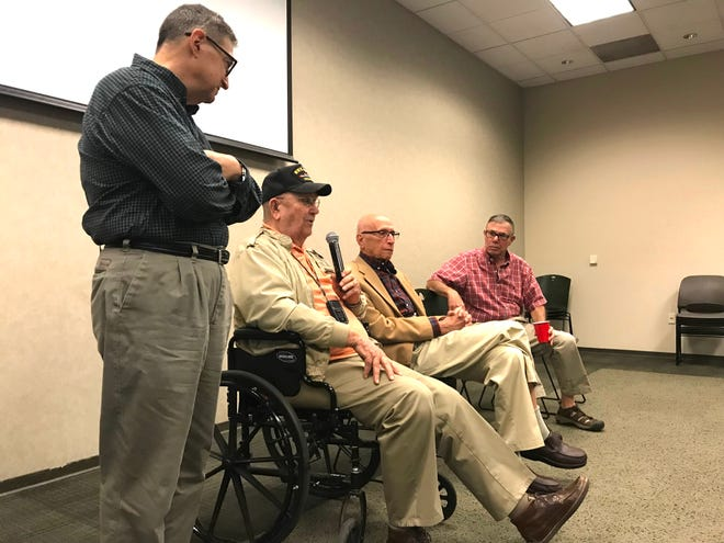 Warren Flourney, a World Warr II veteran talks Sunday about serving in the military with other members of Temple Beth Israel, from left Jeff Hage, Art Tillis and Larry Licker.