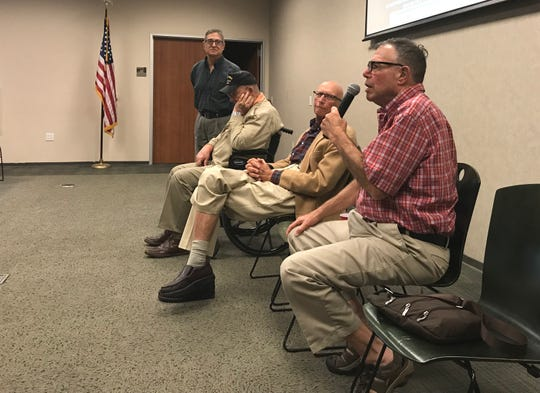 Larry Licker, a member of Temple Beth Israel in Redding, talks Sunday about his service in the Army during the 1960s with other veterans and members of the temple, from left Jeff Hage, Warren Flourney and Art Tillis.