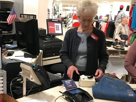 Sheila Dickens rings up a sale at JCPenney. She started her job on October 19.