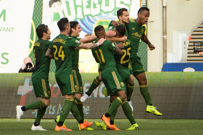 Nov 4, 2018; Portland, OR, USA; Portland Timbers midfielder Sebastian Blanco (10) celebrates with teammates after scoring a goal during the first half against the Seattle Sounders at Providence Park.