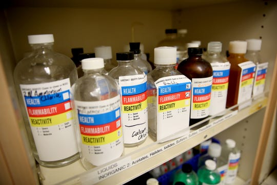 Chemicals are shown in a chemistry classrooms storage cabinet on Friday, Nov. 2 at West Salem High School.