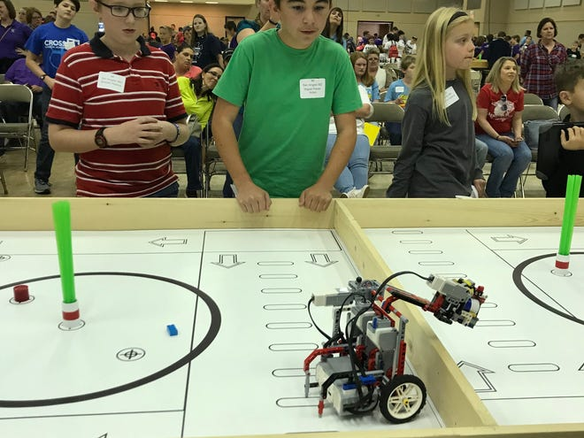 San Angelo ISD students Braiden Perkins and Miguel Flores-Acton watch their robot in the arena at the San Angelo Robotics Competition on Monday, Nov. 5, 2018 at the McNease Convention Center.