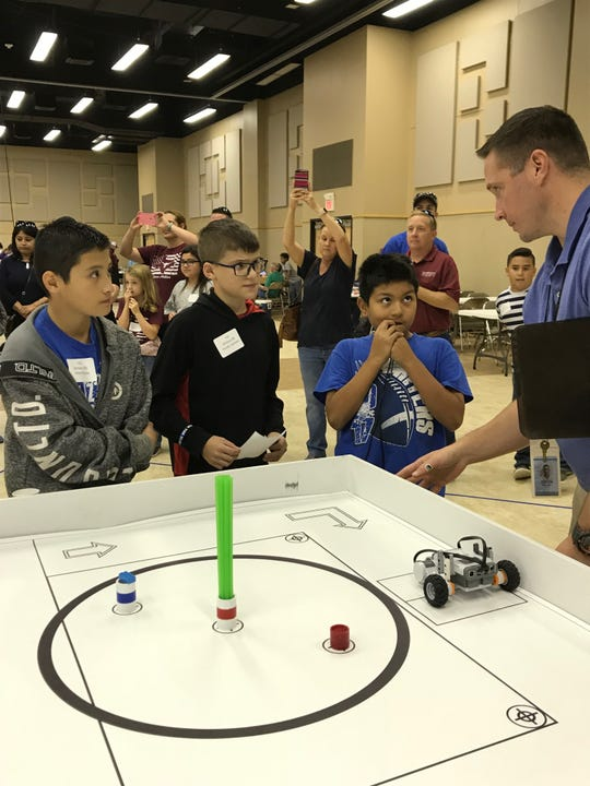 Winters students Adam Rocha, Hunter Jackson and Diego Rodriguez wait for the results of the arena portion of the San Angelo Robotics Competition on Monday, Nov. 5, 2018 at the McNease Convention Center. This trio is in Division 2, which ranges from students in 4th to 6th grade.