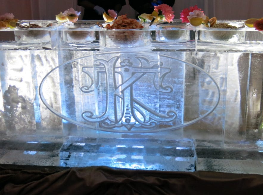 Red River Ice's   10-foot long ice bar weighed 4,800 tons, took two weeks to complete. The Iced Seafood Bar held lump crab meat, boiled gulf shrimp, jumbo crab claws and raw oysters shucked to order.