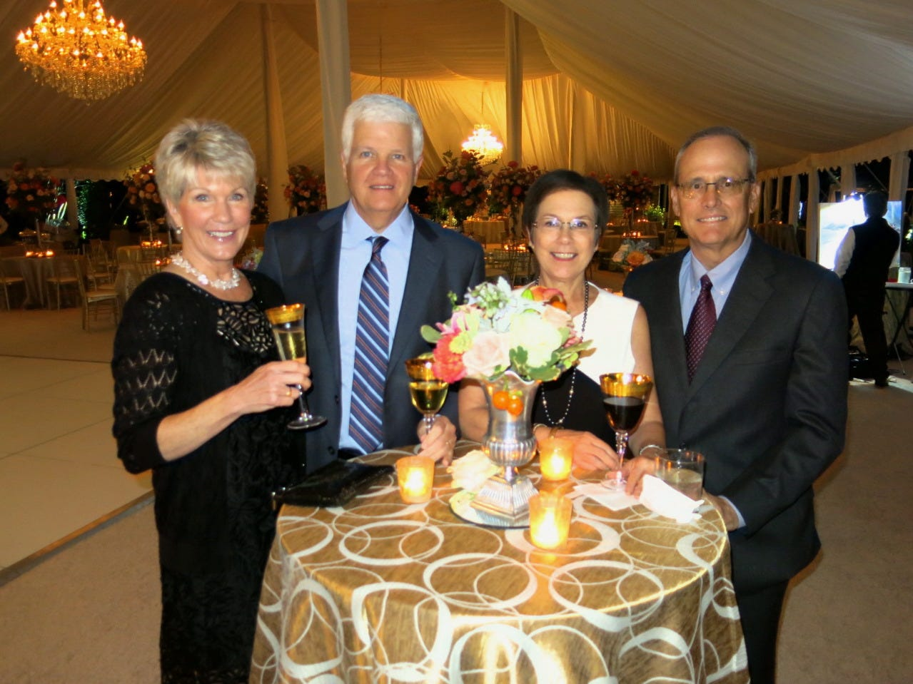 Florence and Jim Bethard and Stacy and Dr. Larry Hand at wedding reception.