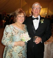 Mom of the groom Lisa Lester wearing a  custom-made dress by Dallas Designer Patti Flowers, and hubby, groom's dad, Ed Lester Jr. at the reception.
