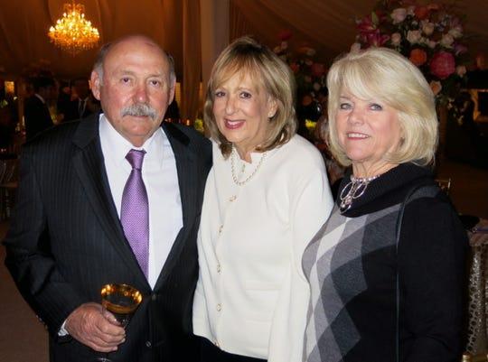 Joe  and Karen Dill, Pat Horton at wedding reception.