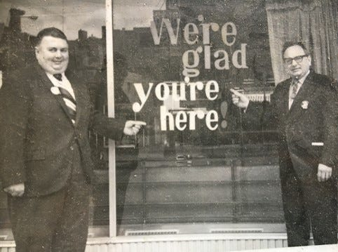 Bob Lyons, right, greets customers in this undated photo.