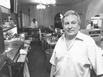 Bob Lyons inside his cafe, undated photo.