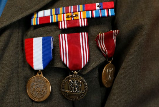 Medals on the jacket of Leonard Branecki, 95, who served as a cryptologist in the Army during World War II.