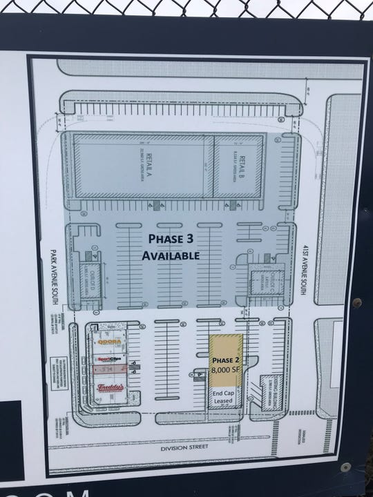 A sign posted at the former St. Cloud Subaru site shows a new retail and dining development coming to Division Street.