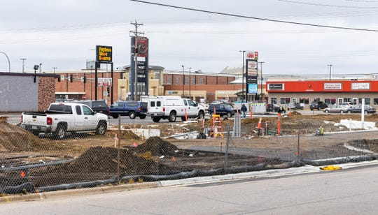 Site preparation is underway at the former Subaru auto lot at 4110 Division St. W, Monday, Nov. 5, in St. Cloud. Signs at the site state Freddy's Frozen Custard and Steakburgers, Qdoba Mexican Eats and Sport Clips will be in the new space.