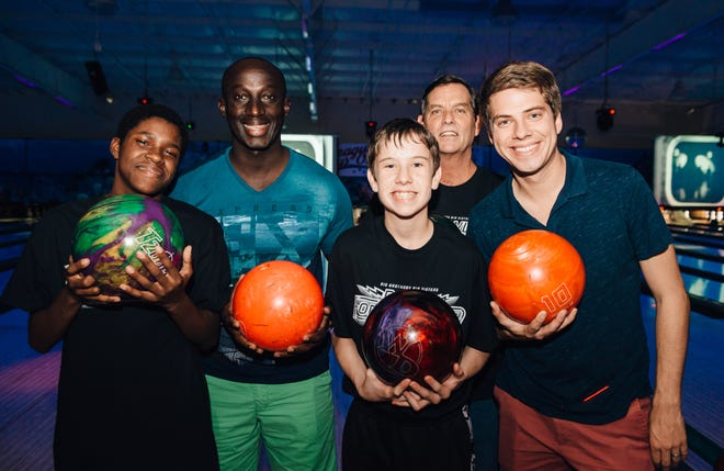 Big Drew and Etienne at the Bowl for Kids event.
