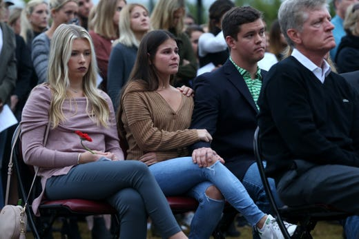 Family members of Maura Binkley, a victim of the shooting at Hot Yoga Tallahassee, attend a vigil held at Florida State University in honor of the two lives that were lost on the night of the shooting at Hot Yoga Tallahassee, on Nov. 4, 2018.