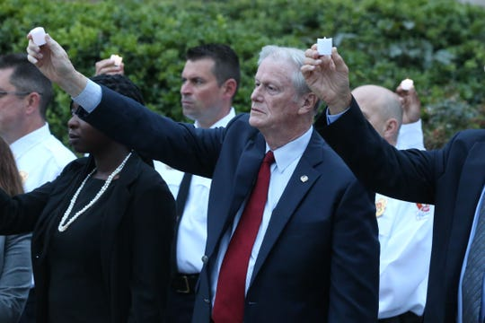 John Thrasher, Florida State University President, holds up a candle at a vigil held at Florida State University in honor of the two lives that were lost on the night of the shooting at Hot Yoga Tallahassee, on Nov. 4, 2018.