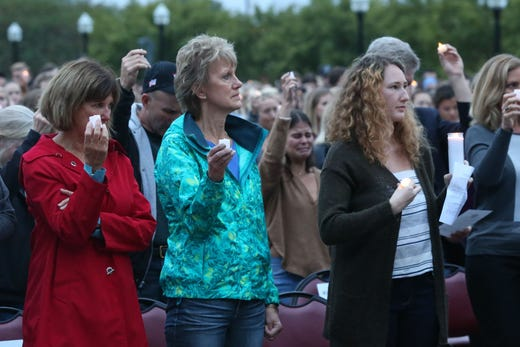 Family members of Nancy Van Vessem, a victim of the shooting at Hot Yoga Tallahassee, attend a vigil held at Florida State University in honor of the two lives that were lost on the night of the shooting at Hot Yoga Tallahassee, on Nov. 4, 2018.