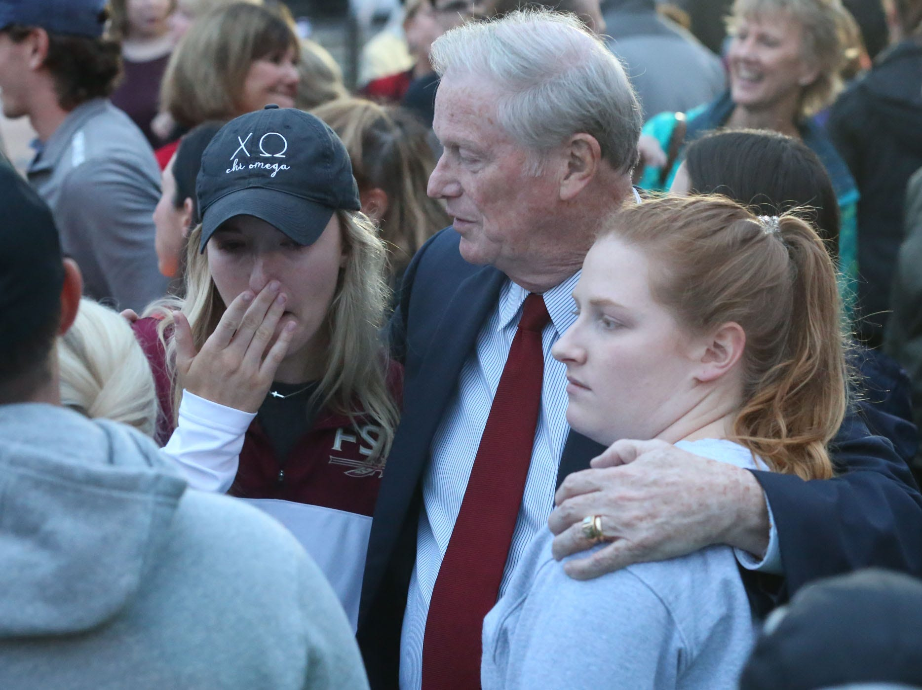 John Thrasher, Florida State University President, consoles students at a vigil held at Florida State University in honor of the two lives that were lost on the night of the shooting at Hot Yoga Tallahassee, on Nov. 4, 2018.