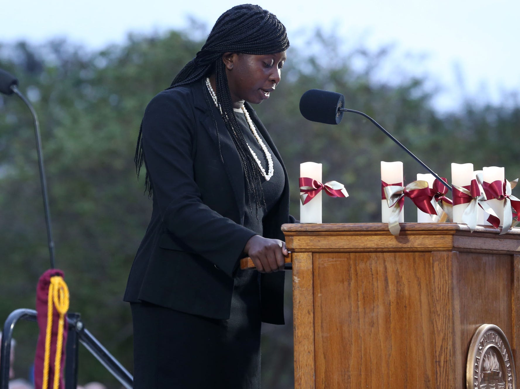 Stacey Pierce, Florida State University Student Body President, speaks at a vigil held at Florida State University in honor of the two lives that were lost on the night of the shooting at Hot Yoga Tallahassee, on Nov. 4, 2018.