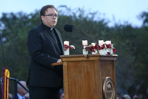 Pastor Jay Winters speaks at a vigil held at Florida State University in honor of the two lives that were lost on the night of the shooting at Hot Yoga Tallahassee, on Nov. 4, 2018.