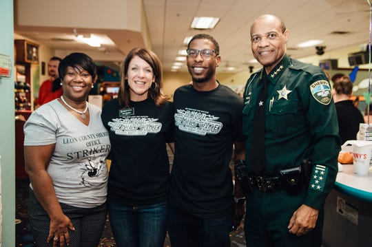 Alva Striplin and Sheriff Walt McNeil with participants at the Bowl for Kids event.