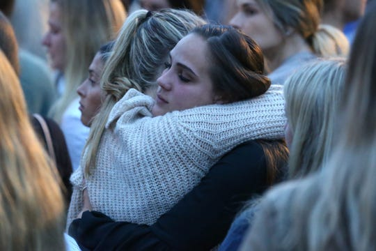 Hundreds of people attended a vigil held on Nov. 4, 2018, at Florida State University in honor of the two lives that were lost in the shooting at Hot Yoga Tallahassee.